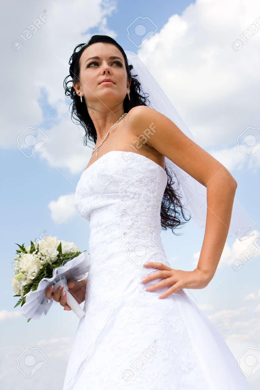 Beautiful bride on the blue sky background Stock Photo - 3582099