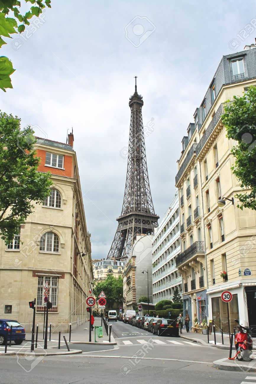 Outdoor cafe in paris with tower in background - French Cafe On The Streets Of Paris France Editorial
