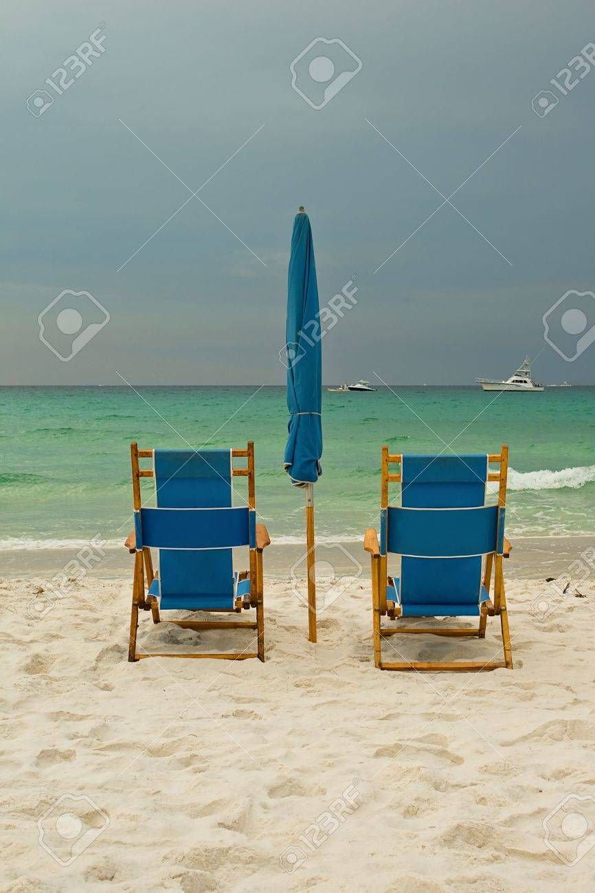 Beach Lounge Chairs Over Cloudy Sky. Destin, Florida, USA Stock Photo    5420357