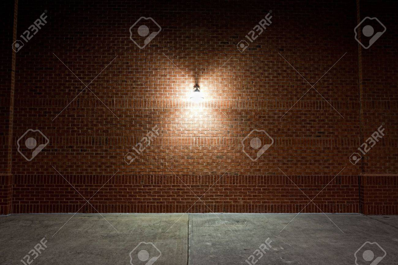Brick Wall Light: Old street light on a red brick wall. Stock Photo - 7492876,Lighting