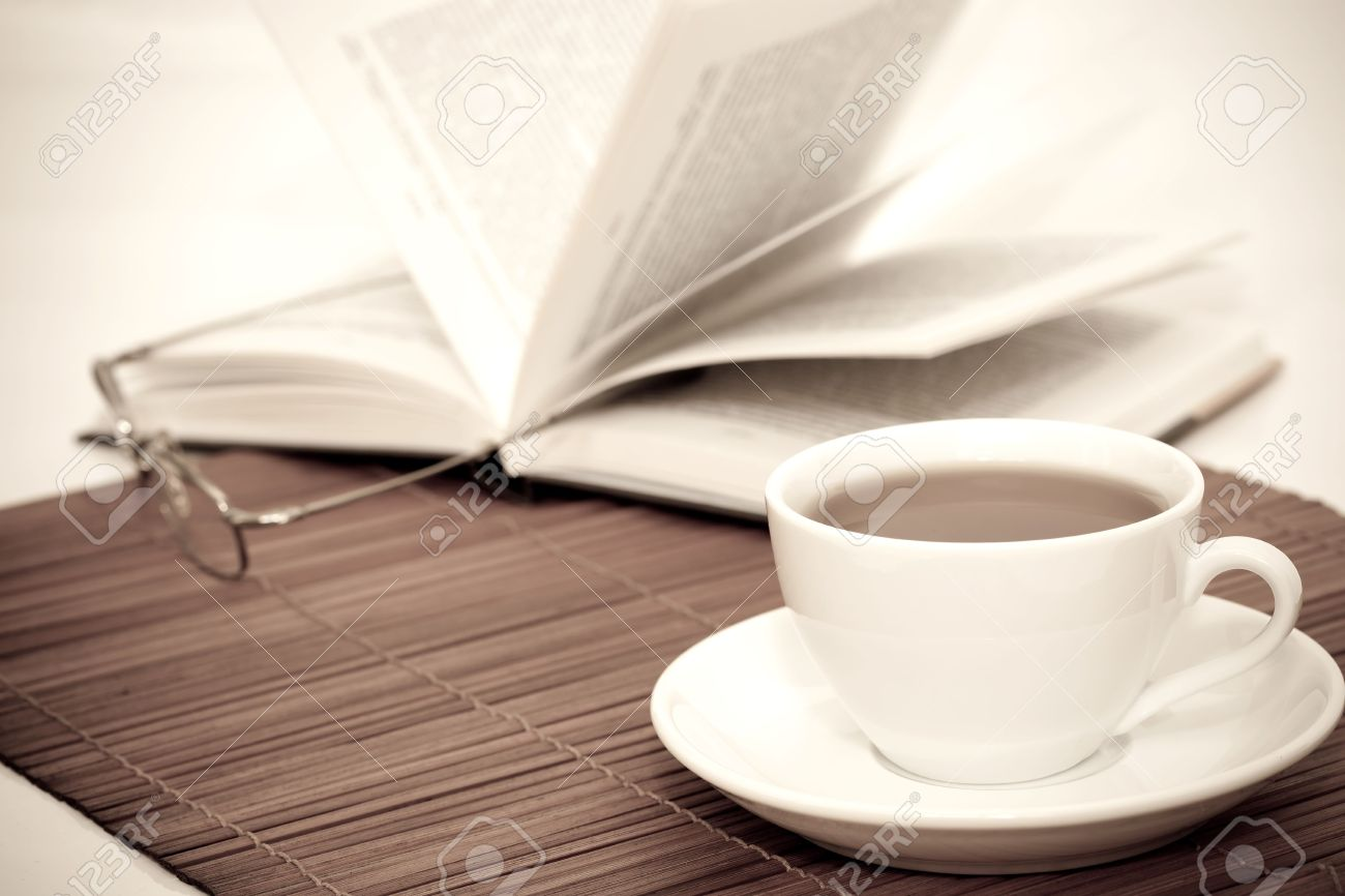 Retro image of white cup of coffee and book with glasses on table retro image of white cup of coffee and book with glasses on table stock photo geotapseo Gallery