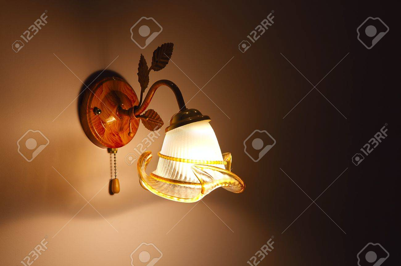 Lighted classic sconce on the wall Stock Photo - 14127255