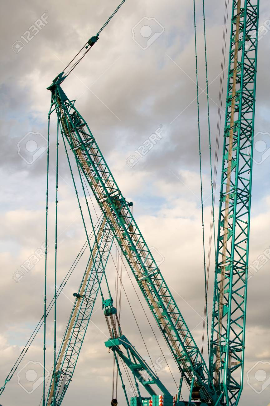 Part of a huge mobile crane on the background of the cloudy sky Stock Photo - 10912435