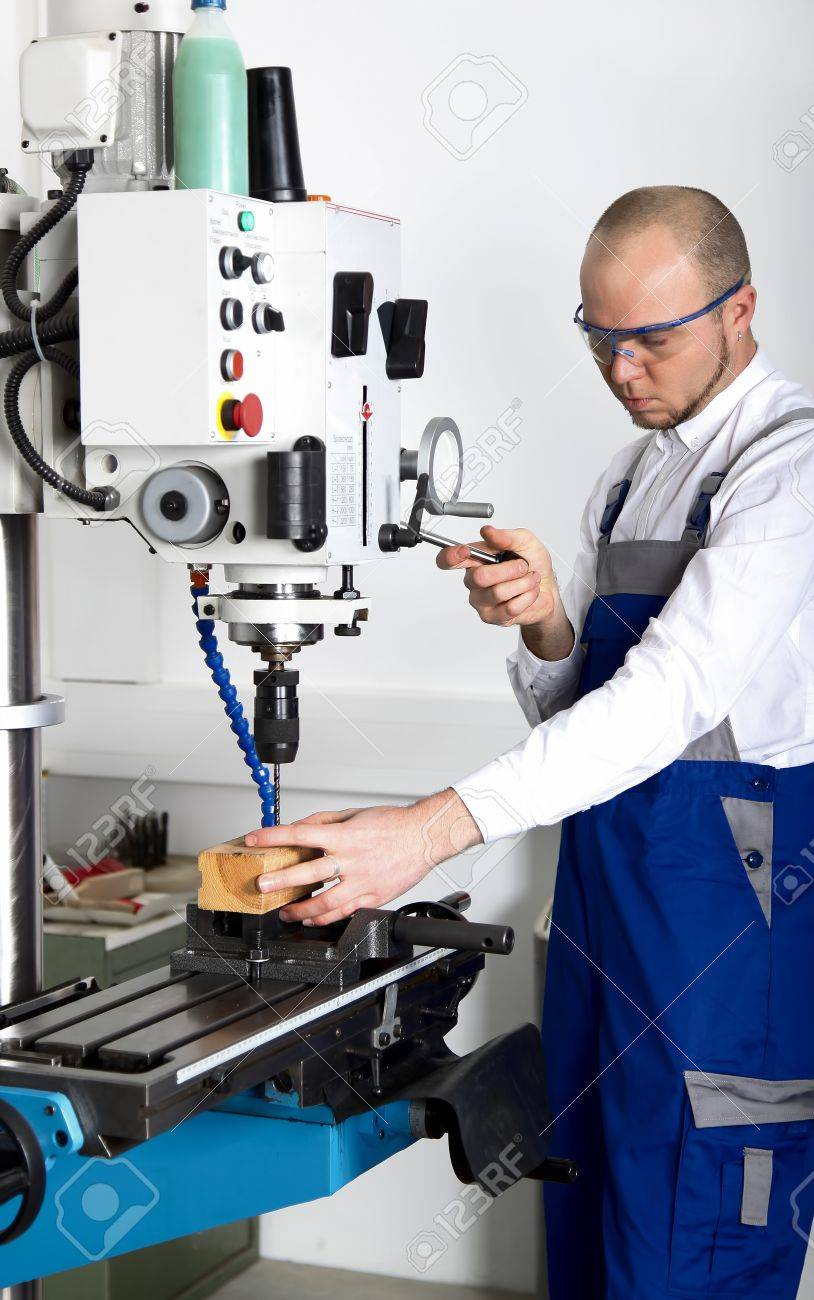 worker with safety glasses at milling machine Stock Photo - 17382867