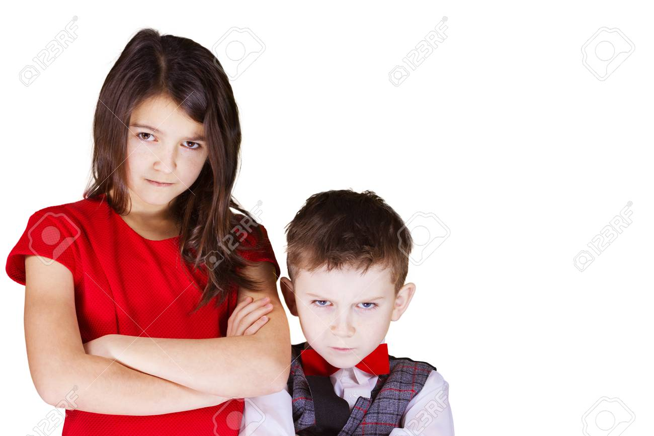 Upset brother and sister looking to camera over white background. - 50460020