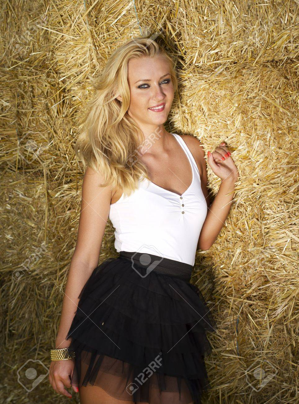beautiful sex young blonde near a straw bales wall stock photo