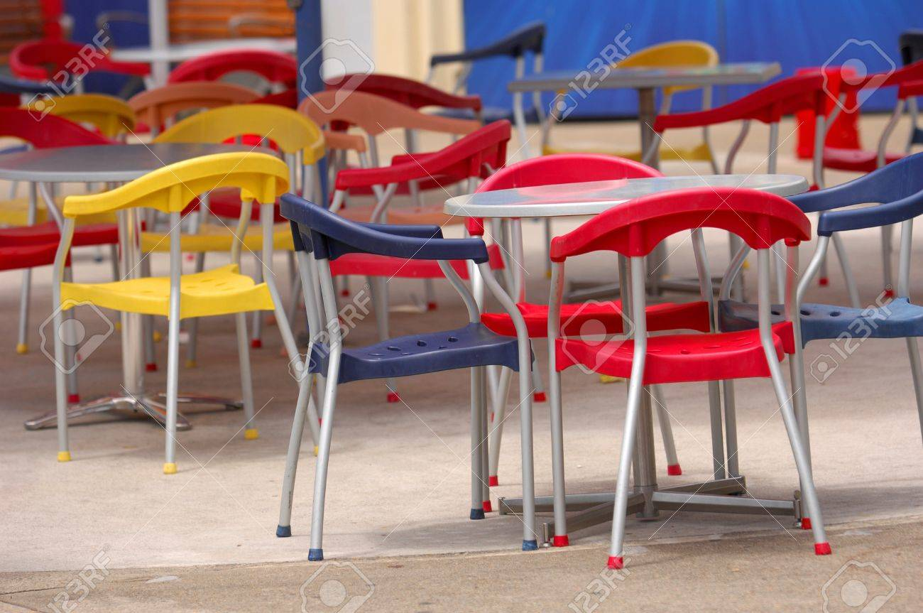 Outdoor cafe chairs - Colorful Outdoor Cafe Chairs Stock Photo 4176594