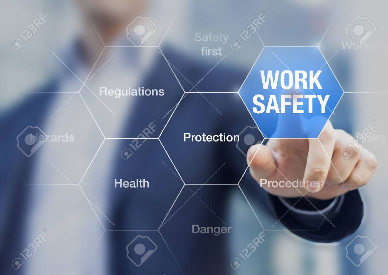 Businessman presenting work safety concept, hazards, protections, health and regulations - 70543706