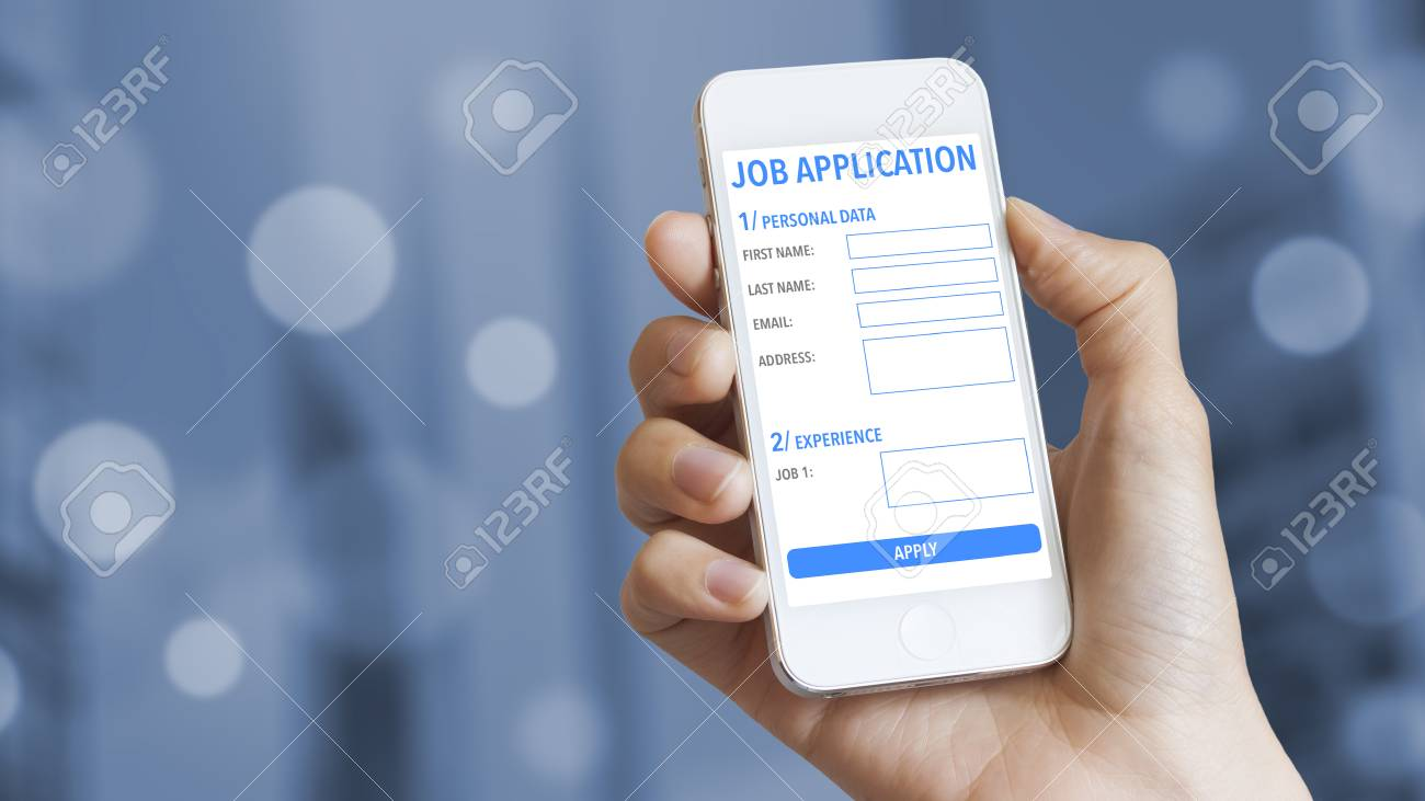 Online job application on mobile phone with business district