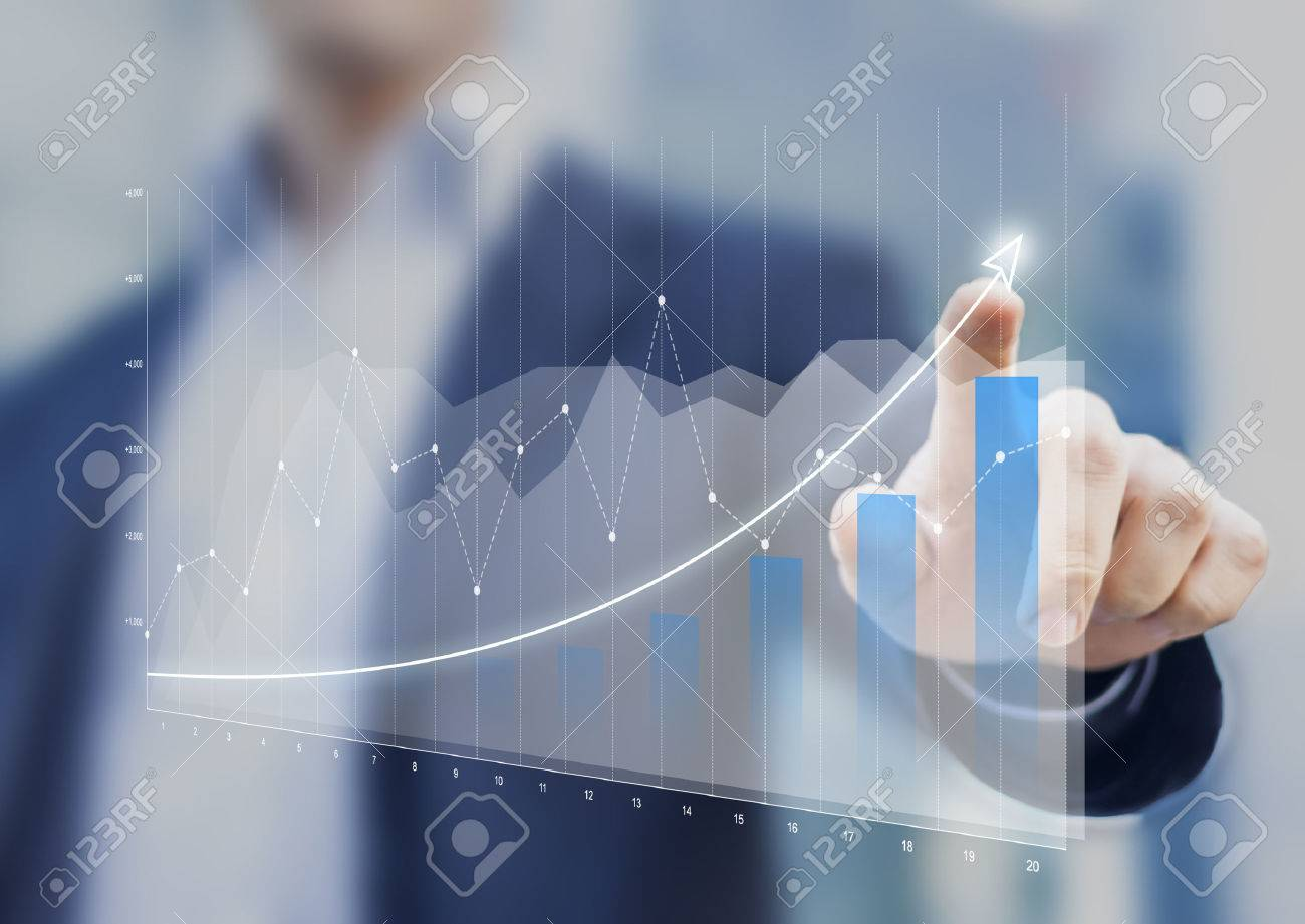 Financial charts showing growing revenue on touch screen - 70543628