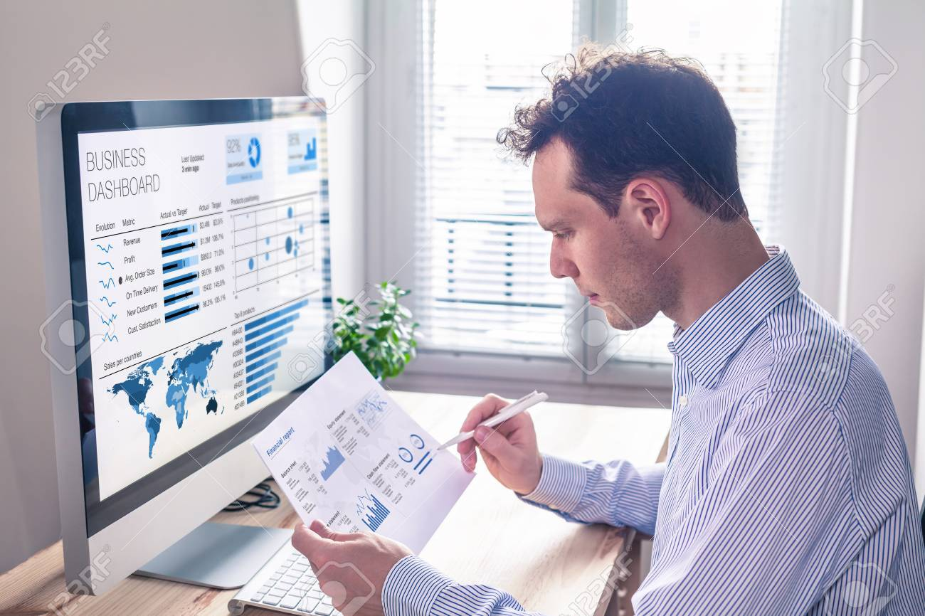 Businessman working with dashboard and key performance indicator (KPI) metrics, business intelligence (BI) graph and charts and financial report data with computer in office - 87166584