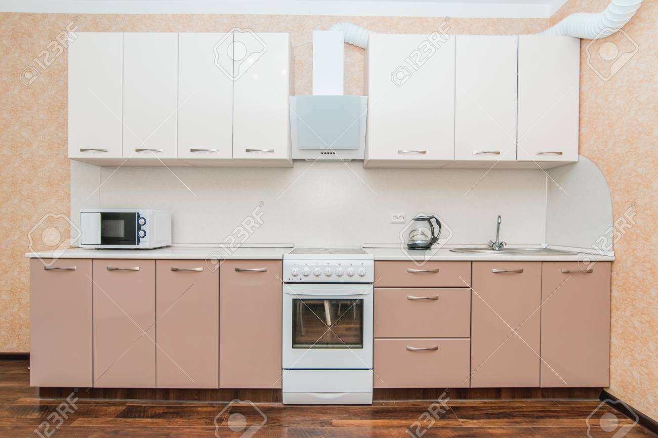 The photo of completely equipped light kitchen with household appliances - 122290621