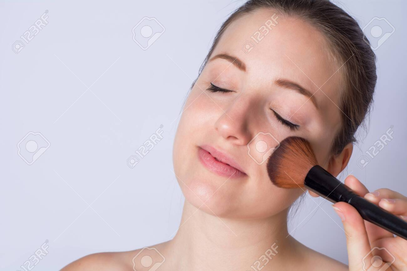 Portrait Of Young Woman Applying Foundation Powder With Makeup Stock Photo Picture And Royalty Free Image Image 131277179