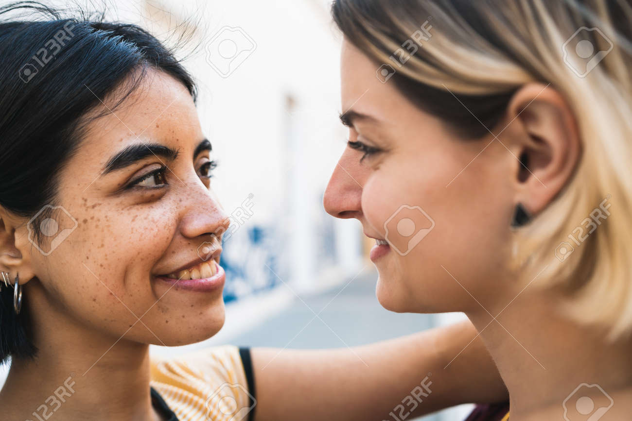 Portrait of happy couple spending time together and hugging at the street. LGBT concept. - 146979836