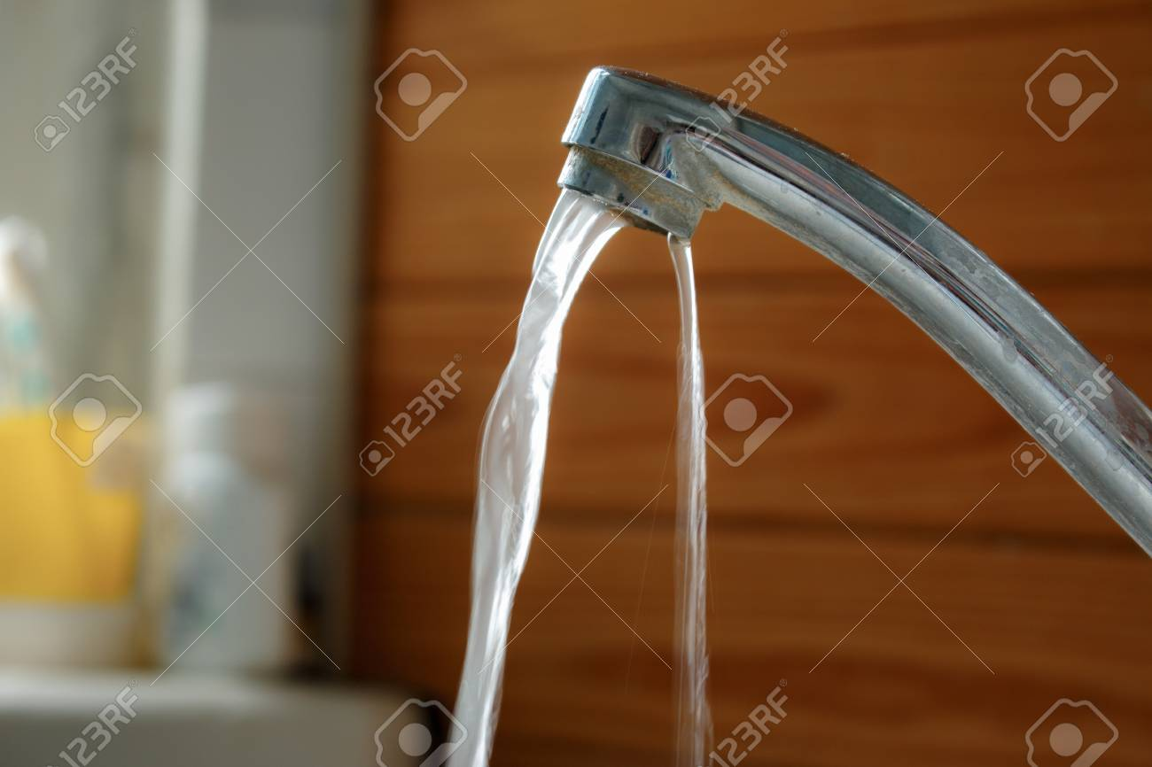Broken Aluminum Faucet In The Bathroom From The Sink Stock Photo ...