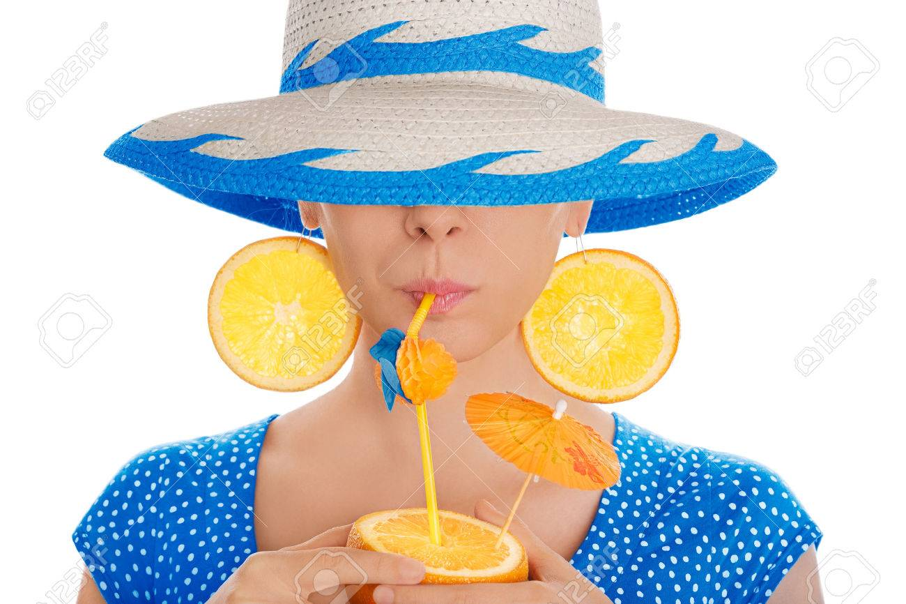 8fdf0f14eb9 Girl with Orange Drink and Orange Slice Earrings Wearing Hat White  Background Stock Photo - 28286737