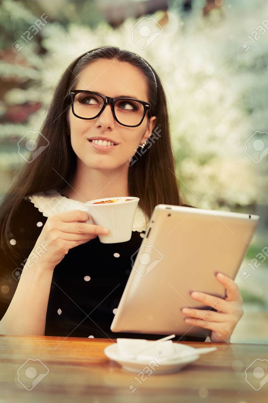 Young Woman with Glasses and Tablet Having Coffee Stock Photo - 29679331