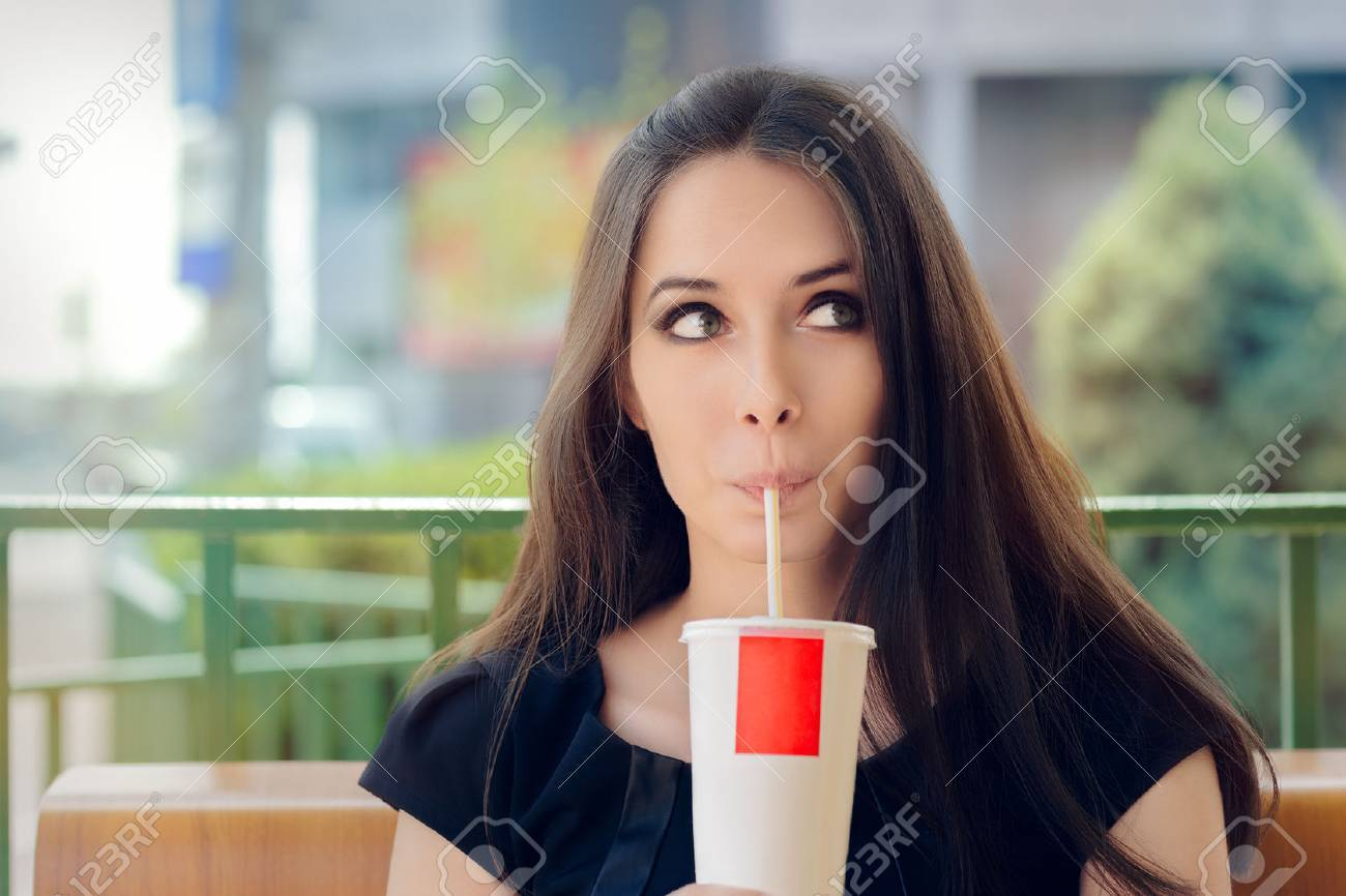Young Woman Having a Summer Refreshing Drink Outside - 39496206