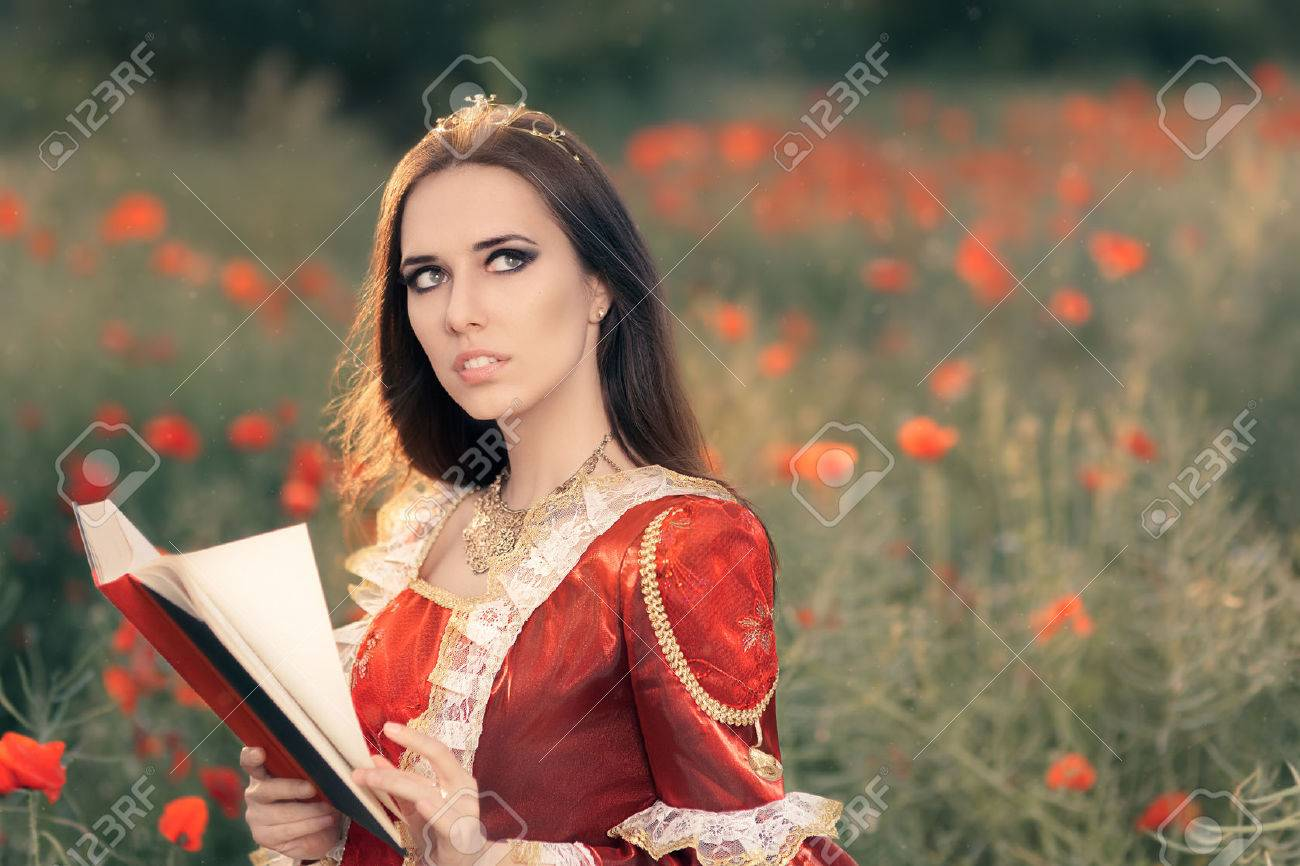 Beautiful Princess Reading a Book in Summer Floral Landscape - 40493635