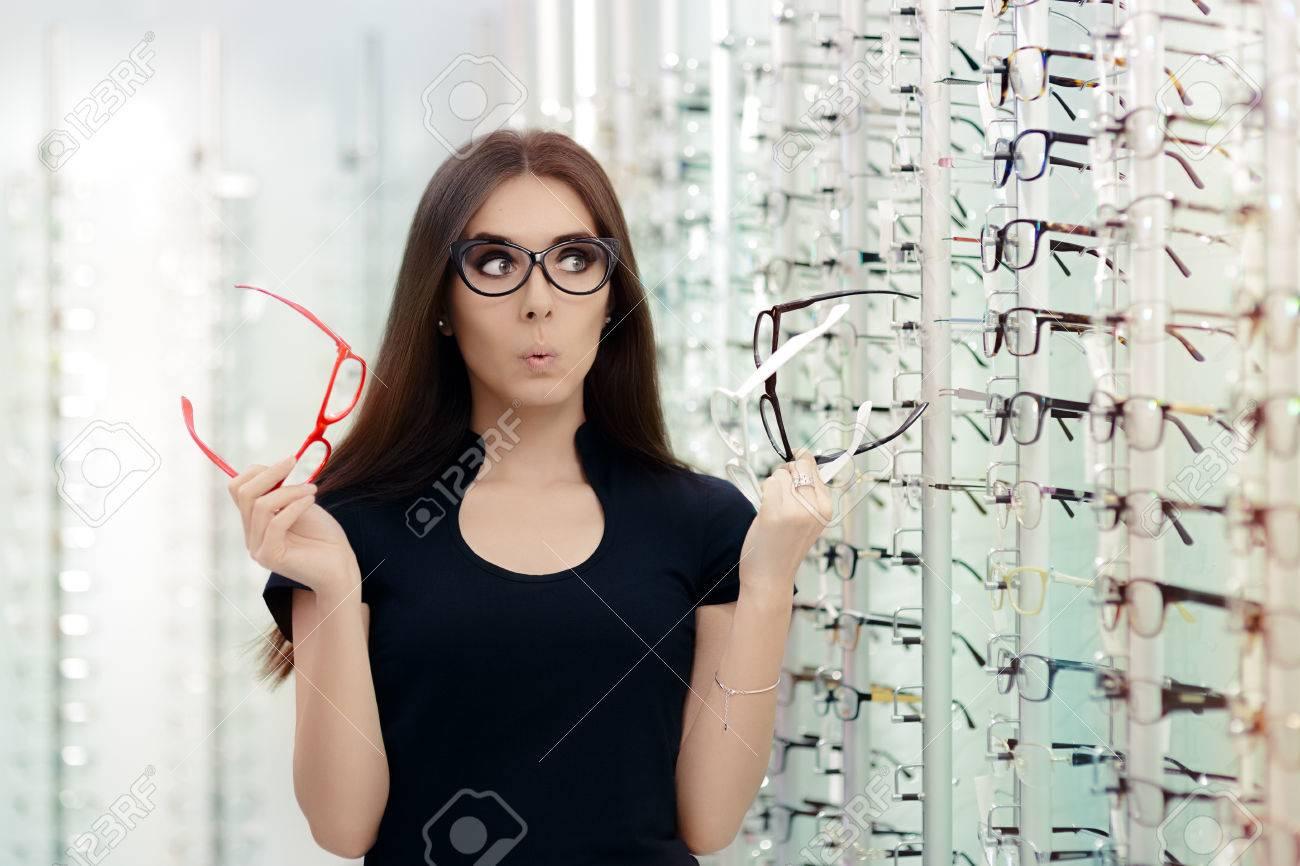 Woman Choosing Eyeglasses Frames in Optical Store - 55798199