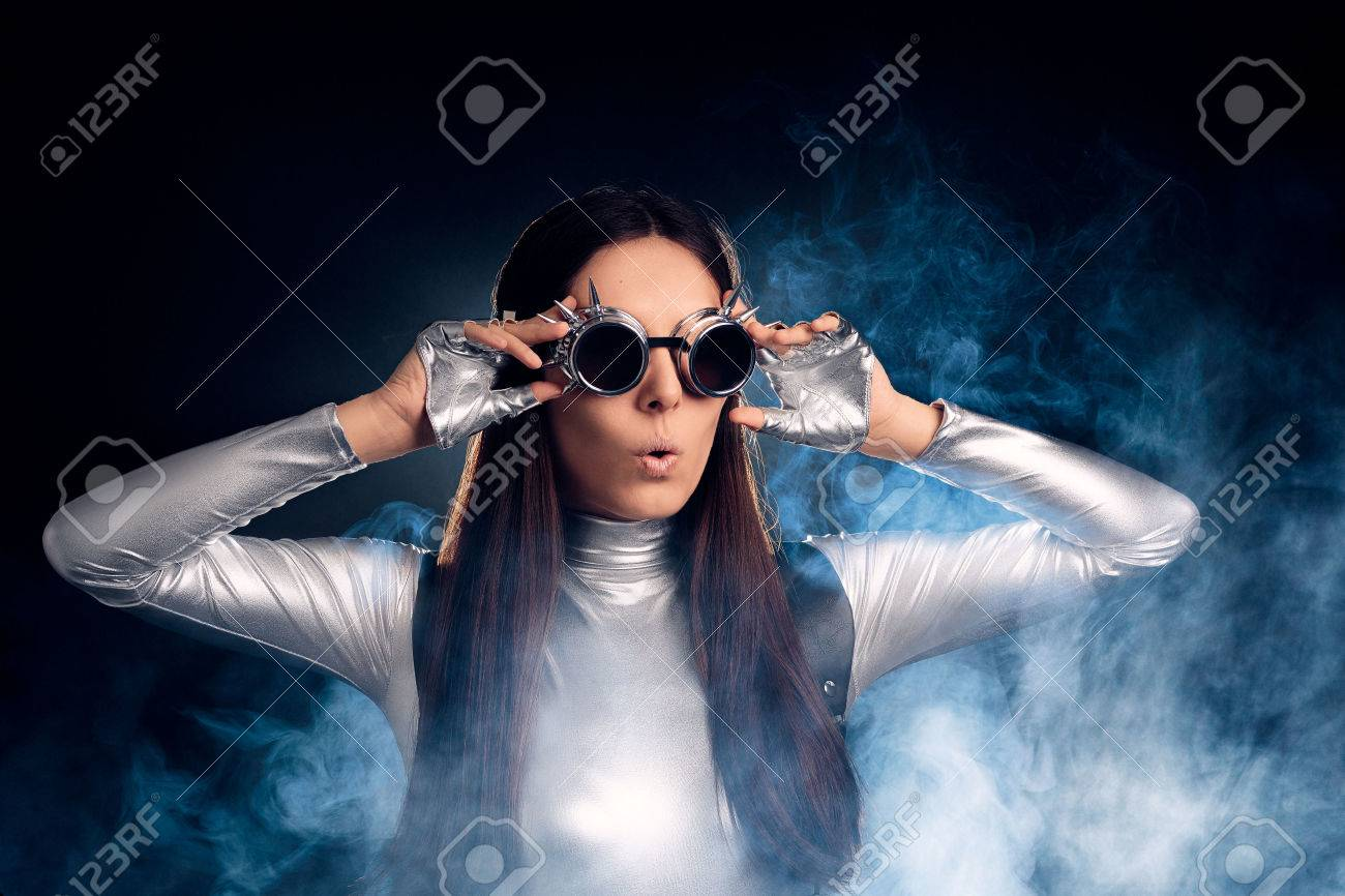 Surprised Woman in Silver Costume and Steampunk Glasses - 59644033