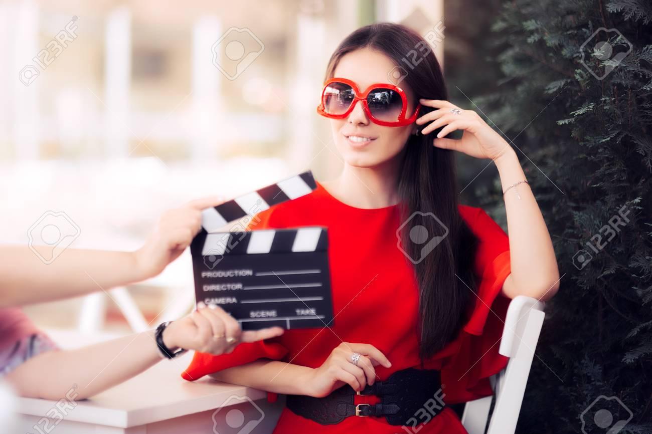 Happy Actress with Oversized Sunglasses Shooting Movie Scene - 72727255
