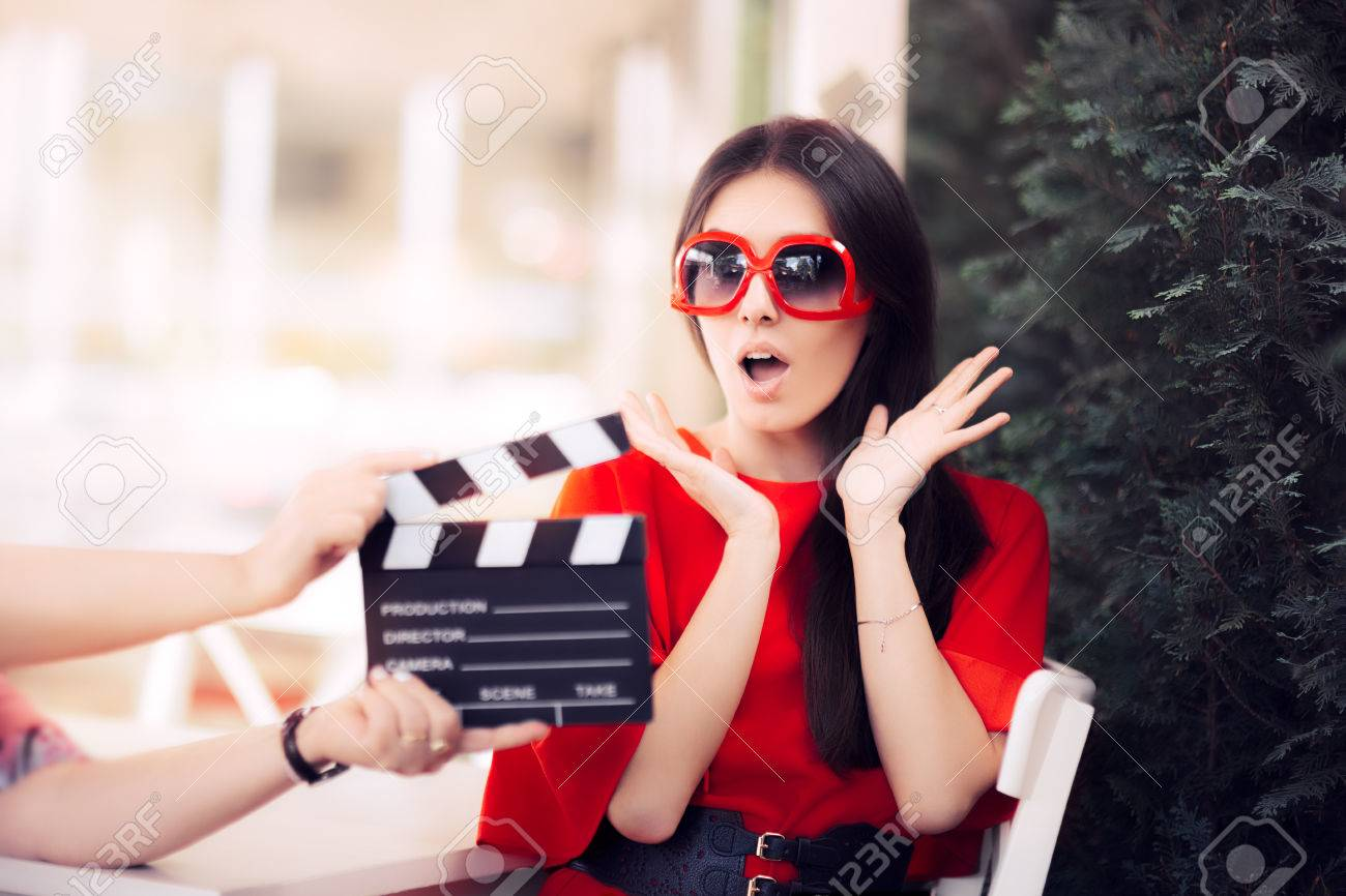 Surprised Actress with Oversized Sunglasses Shooting Movie Scene - 72727260
