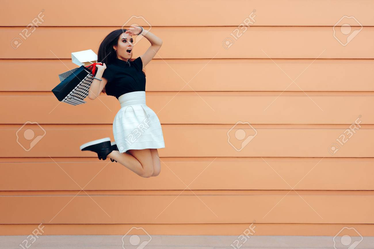 Surprised Woman Running With Shopping Bags in Summer Sale Season - 82012427