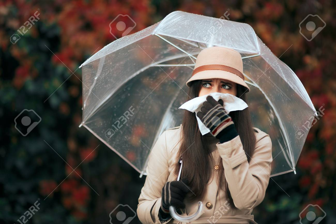 Sick Woman Holding Umbrella in Autumn Rain Blowing Her Nose - 85410035