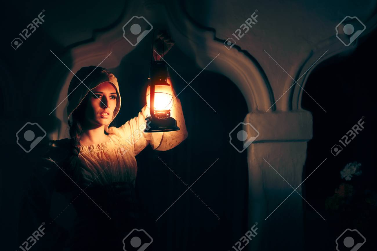 Medieval Woman with Vintage Lantern Outside at Night - 86584607