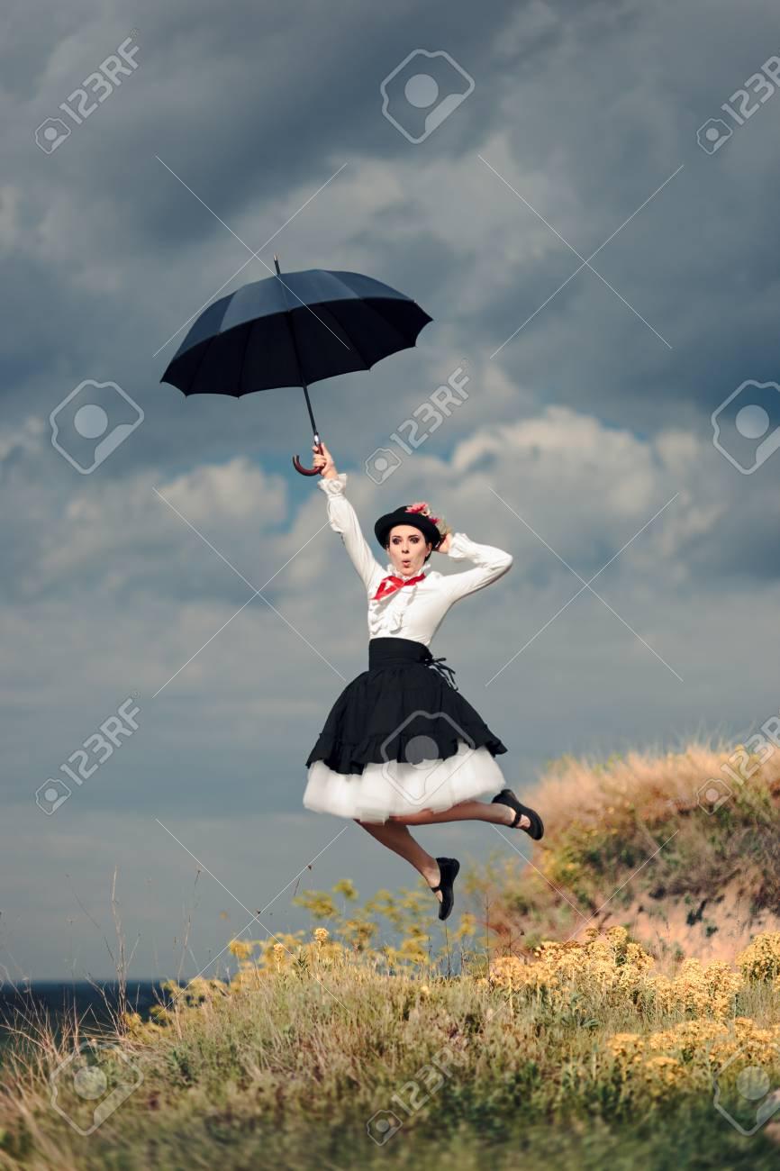 53a52dcfa8c01 Retro Woman with Umbrella Up in The Air in Fantasy Portrait Stock Photo -  88884169