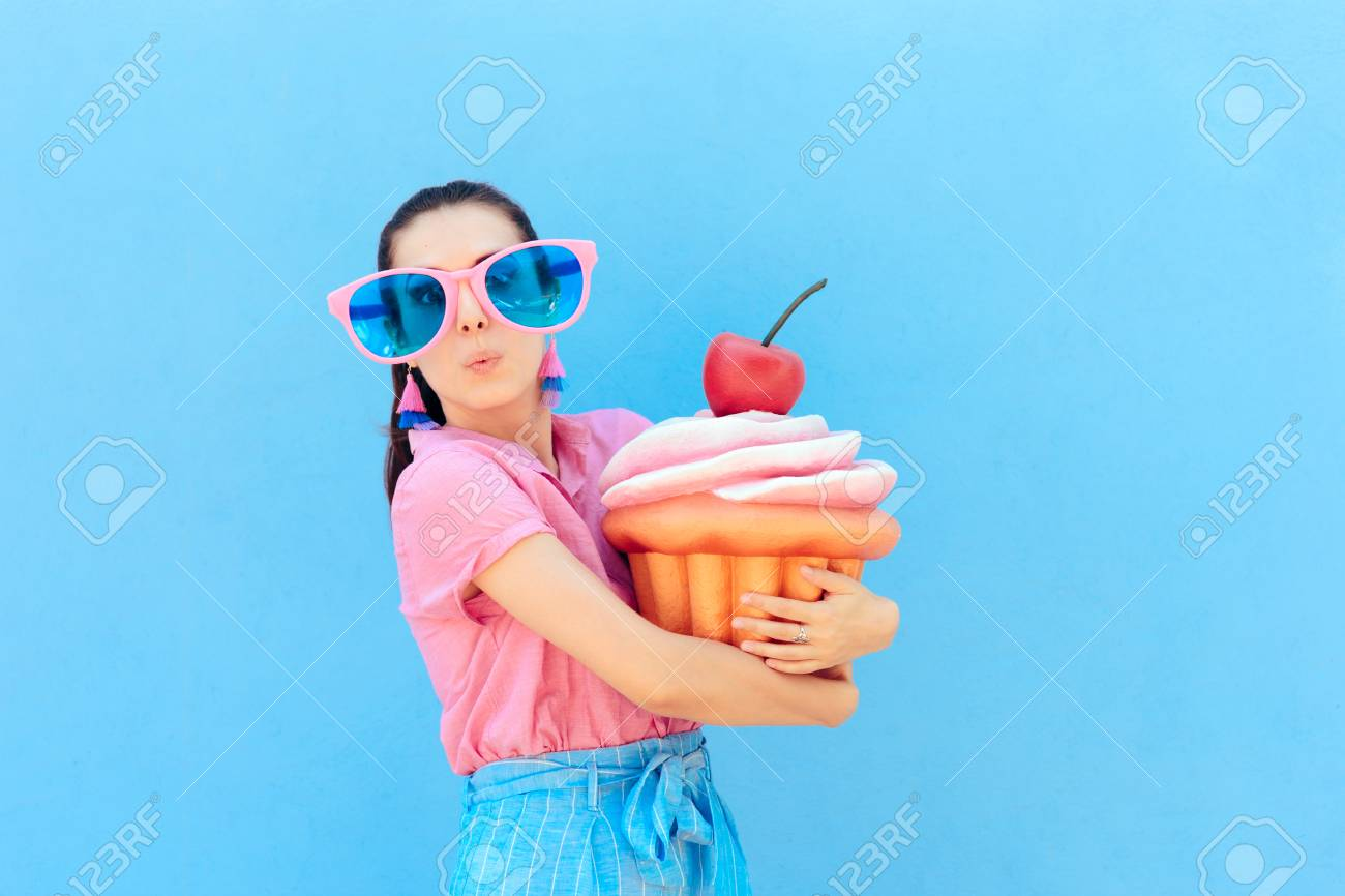 fc6bbe734aaa Funny Party Girl with Big Sunglasses and Huge Cupcake Stock Photo -  105291710