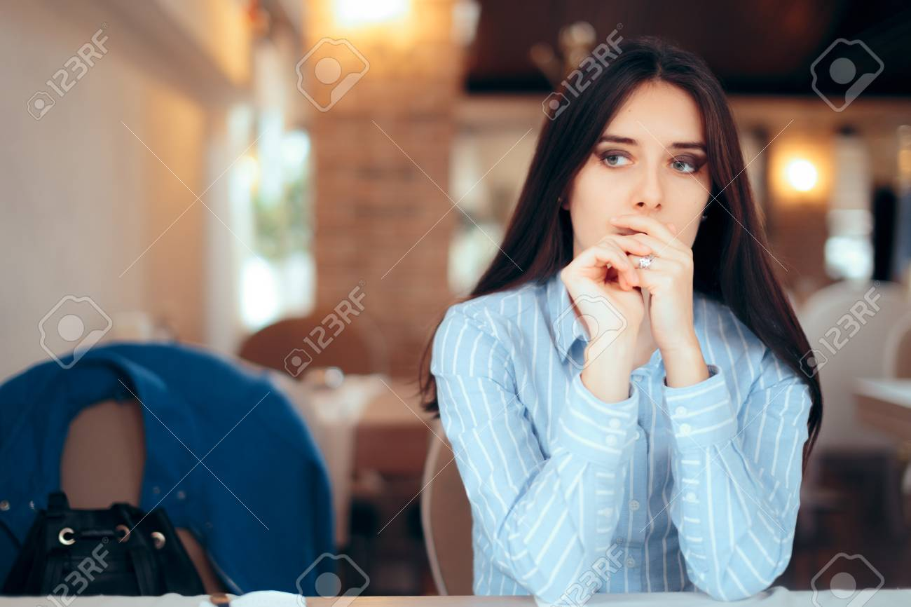 Sad Woman Removing Wedding Ring Thinking about Divorce - 107324559