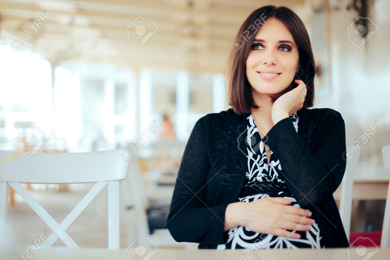 Happy Pregnant Woman Sitting in a Restaurant - 171415162