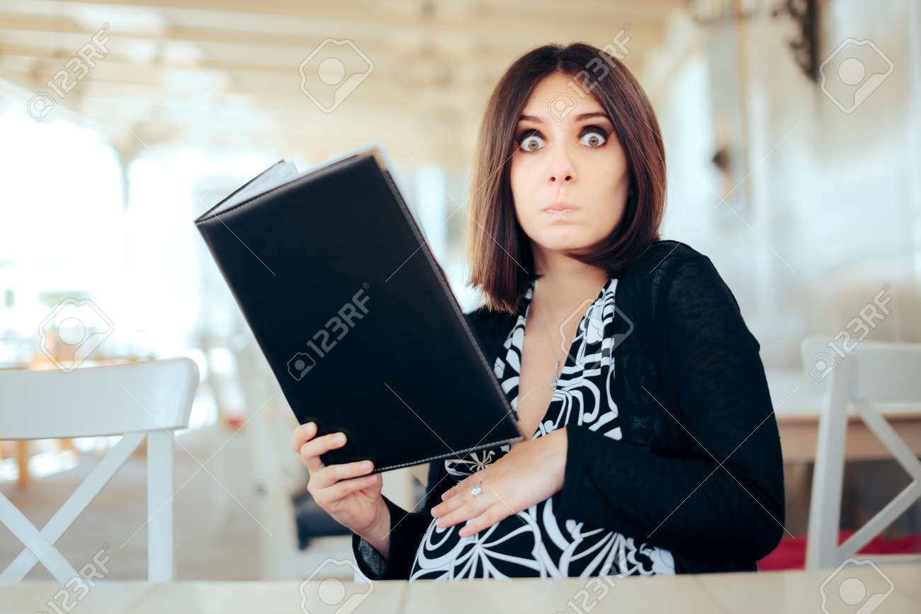 Funny Hungry Pregnant Woman Holding a Food Menu - 171415170