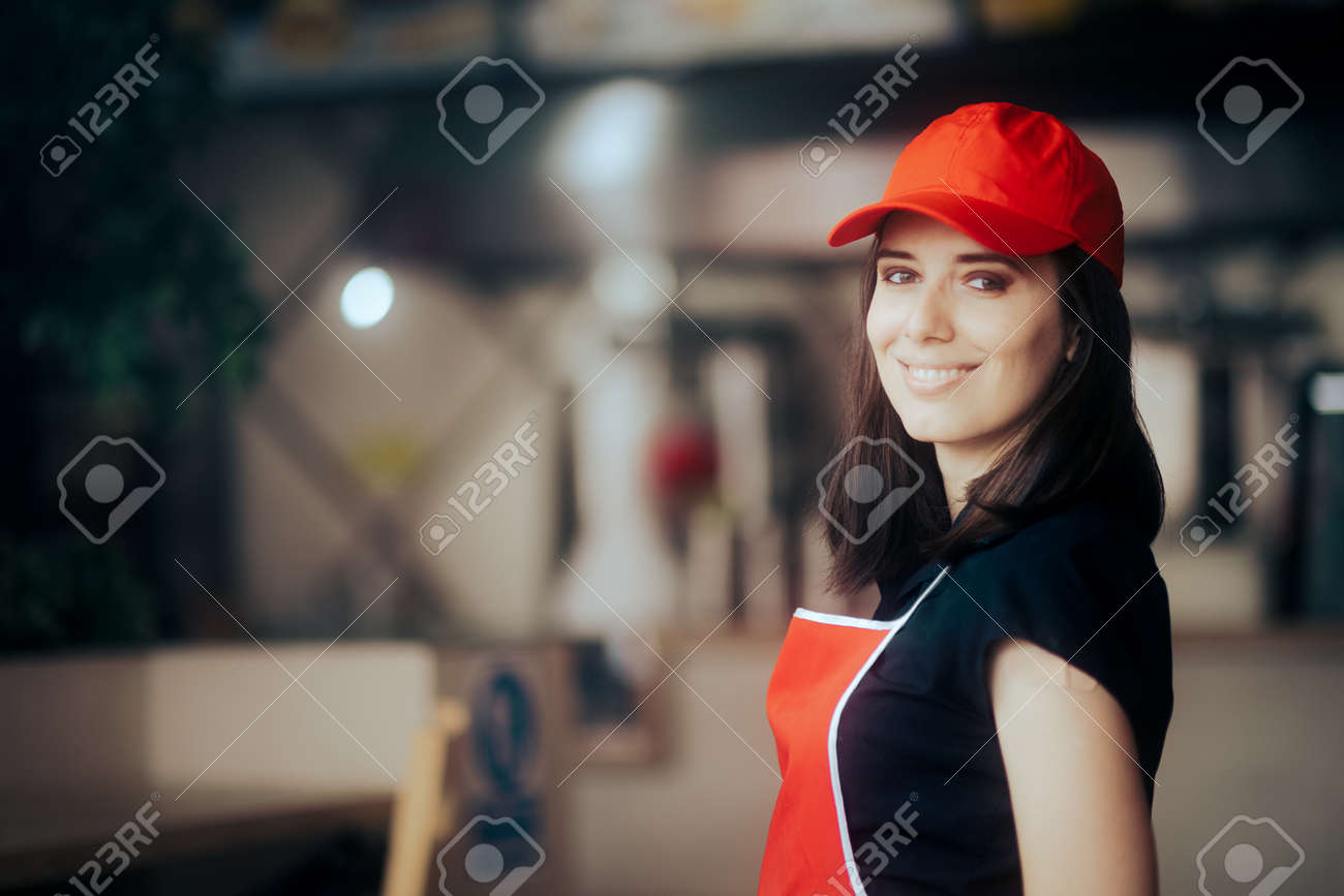 Happy Smiling Fast-Food Worker Standing in a Restaurant - 171551768