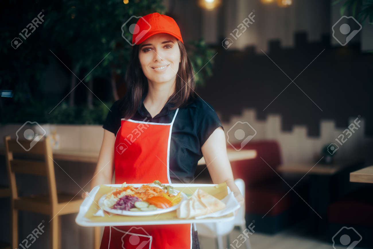 Happy Waitress Holding Food Tray Working in a Restaurant - 171586499