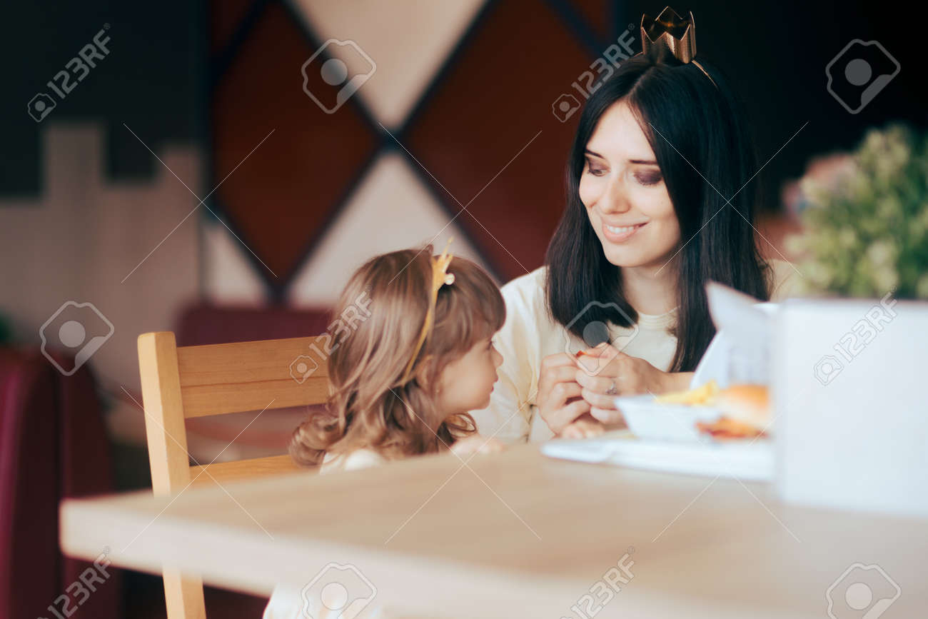 Mother and Daughter Celebrating at Fast Food Birthday Party - 171586502