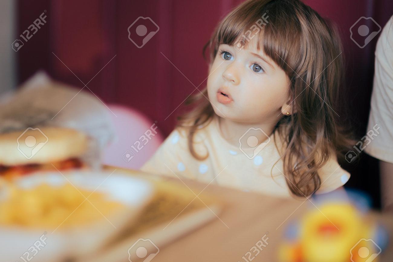 Cute Little Girl Sitting in a Fast-Food Restaurant - 171549968