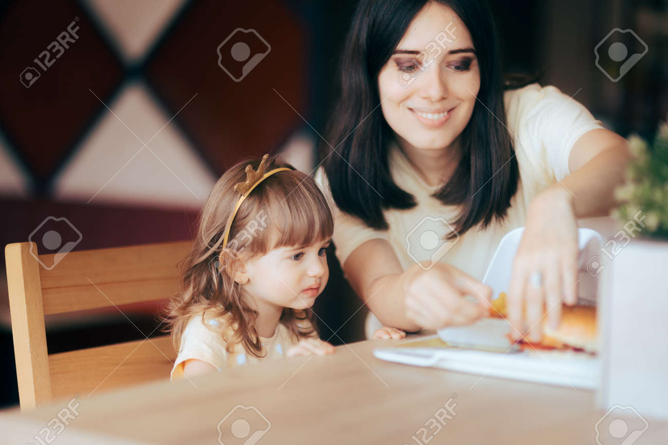 Mother and Daughter Celebrating at Fast Food Birthday Party - 171586503