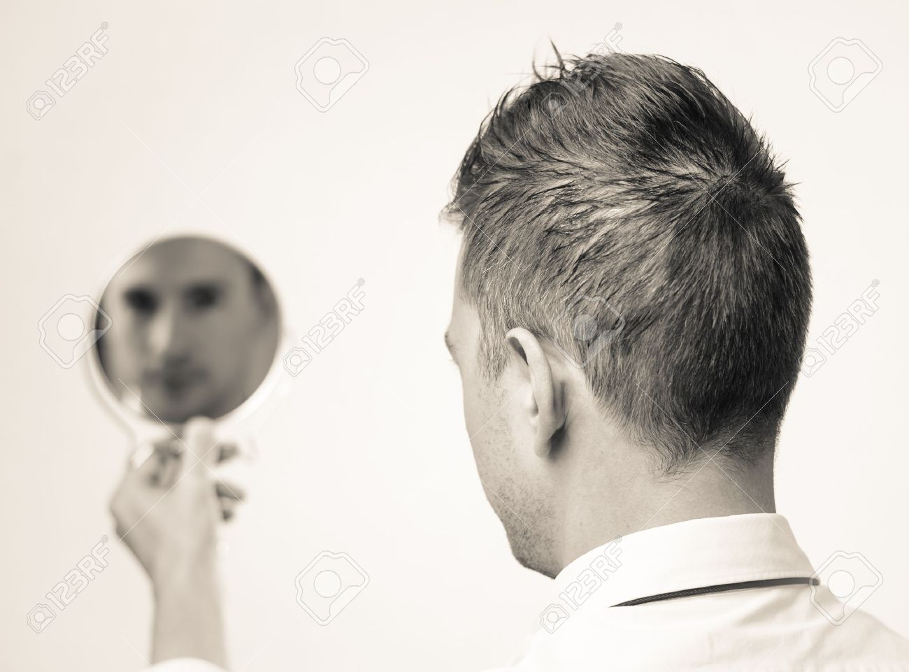 ego business man looking in the mirror and reflecting stock photo