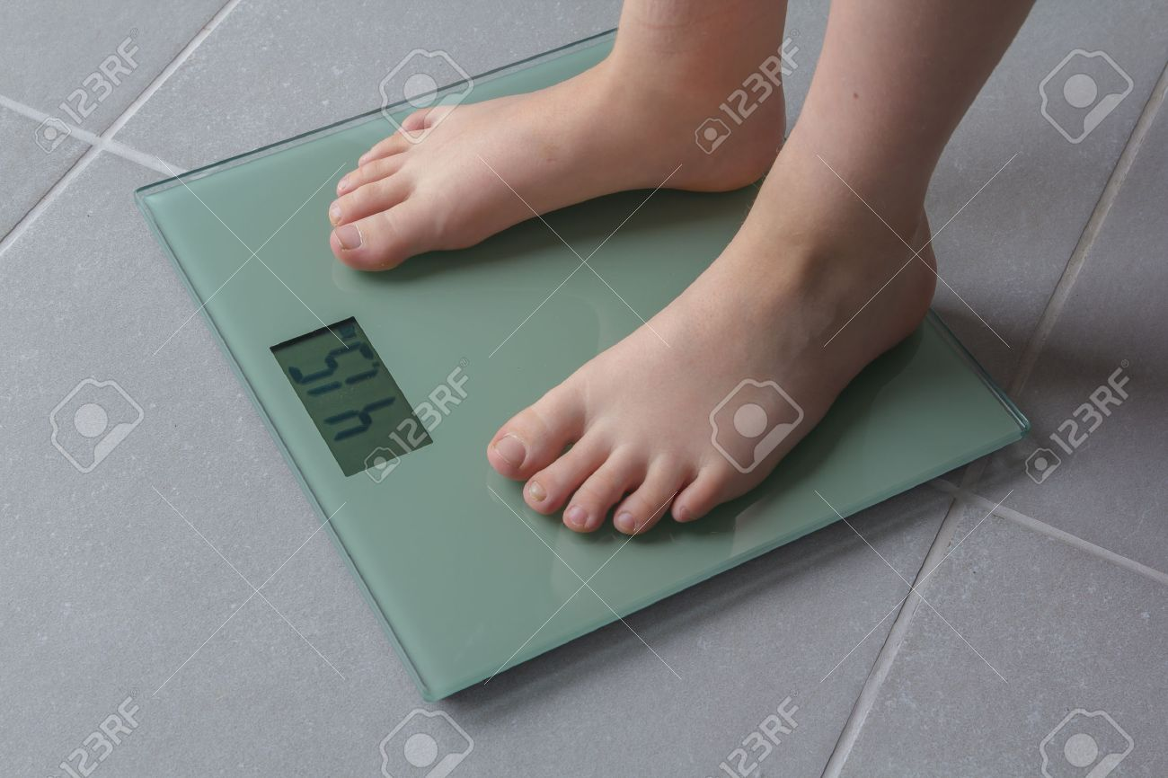 Stand up bathroom scales - Stand On Toes Child With Bare Feet On A Bathroom Scale Of Glass