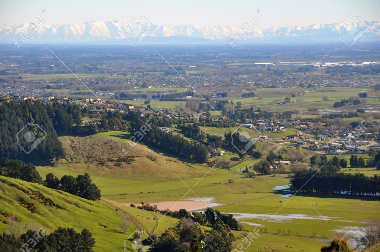 The Canterbury Plains featuring the outskirts of the city of Christchurch in the foreground and the Southern Alps in the far distance Stock Photo - 12580910