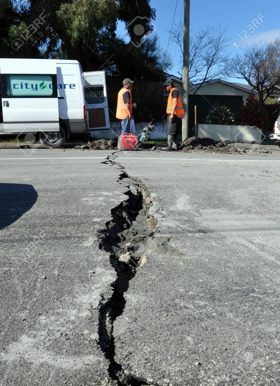 Christchurch, New Zealand - September 06, 2010: Two City Care workers fixing the cracks in the roads in Avonside take a well earned break in the aftermath of the biggest quake Christchurch has ever experienced - 7.1 on the Richter Scale on September 06, 2 Stock Photo - 12571772