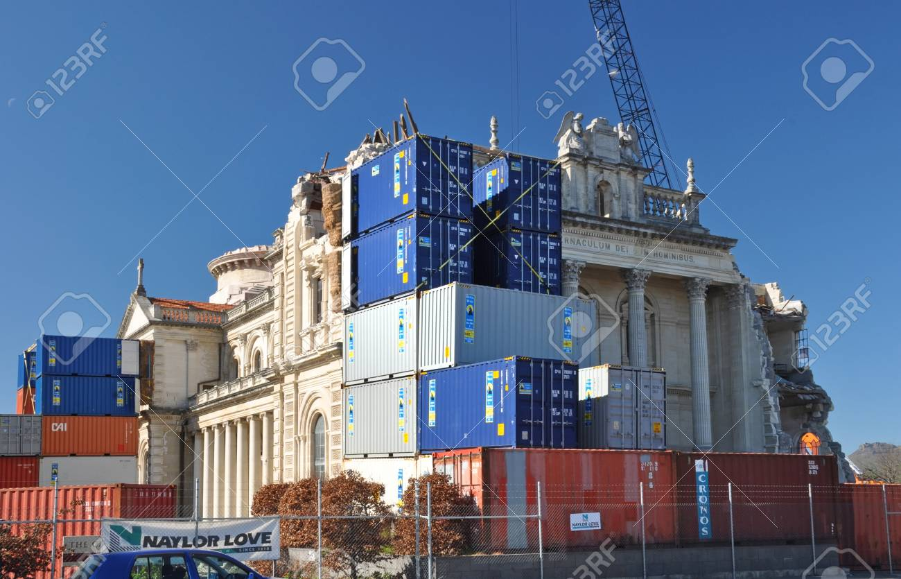 Christchurch, New Zealand - September 03, 2011: Contaners are stacked against the walls of the Cathedral to ensure no further damage occurs during restoration. Note also the use of bales of straw to cushion the impact of the containers. Stock Photo - 14755549