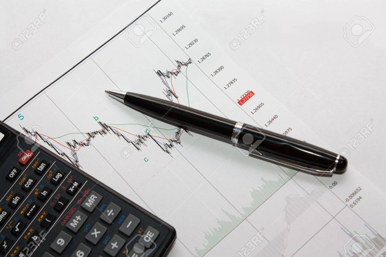 Pen and calculator on charts Stock Photo - 12863056