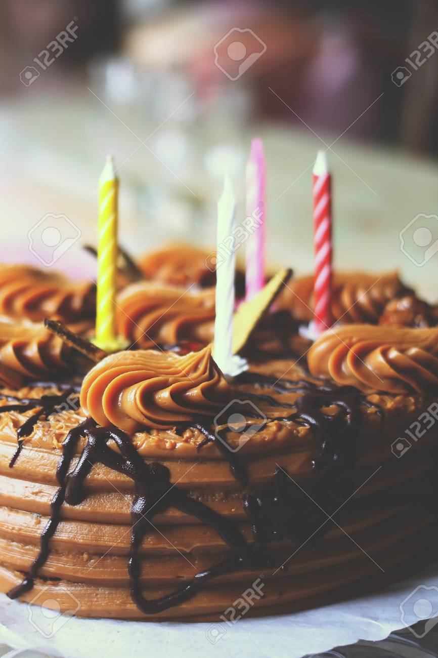Happy Birthday Cake With Burning Colorful Candles Stock Photo