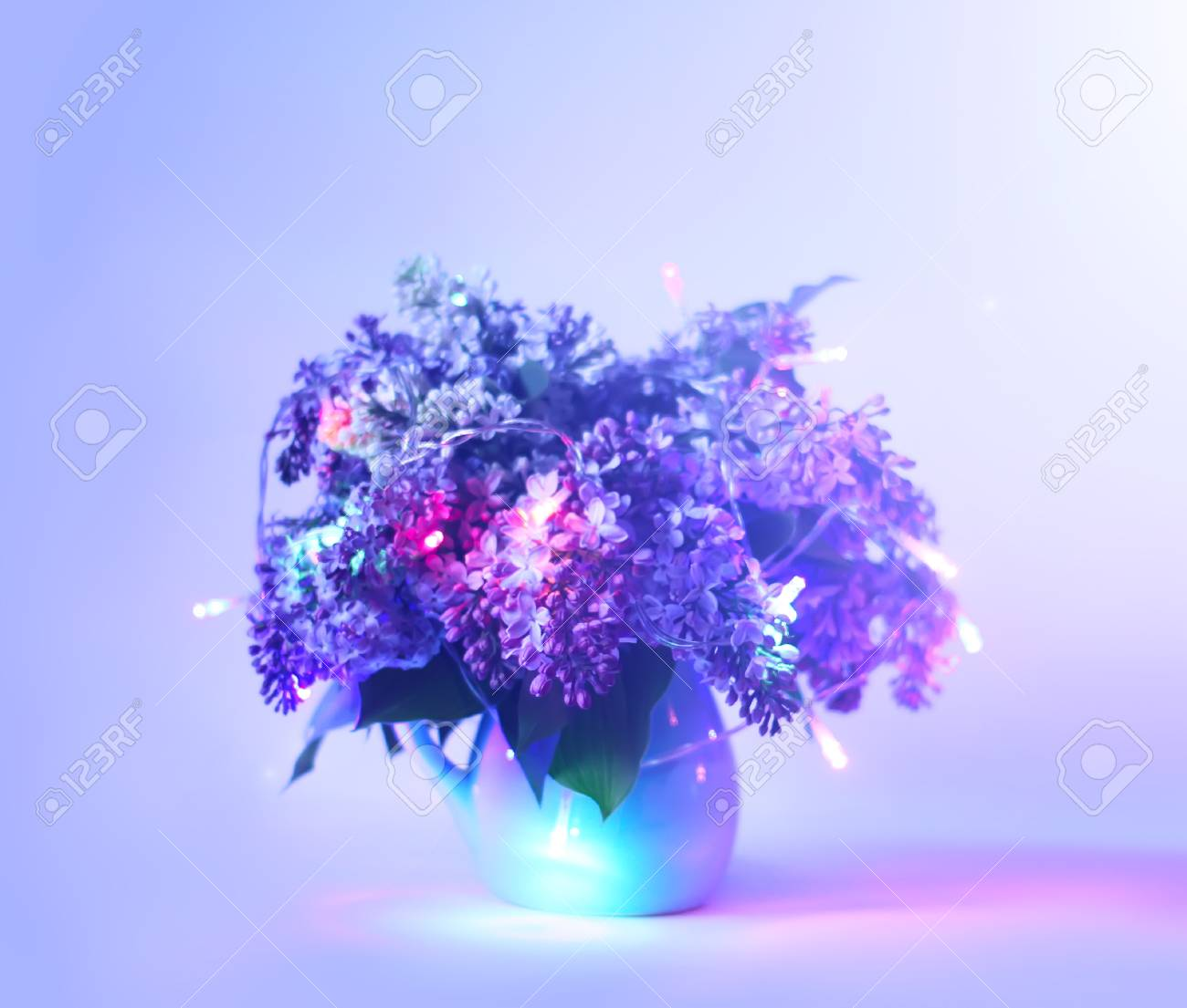 Beautiful Bouquet Of Fragrant Purple Flowers In Blue Ceramics Stock Photo Picture And Royalty Free Image Image 101306327