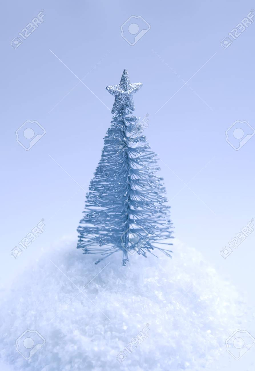 Small Silver Christmas Tree.Decorative Small Silver Christmas Tree On Fluffy Snow