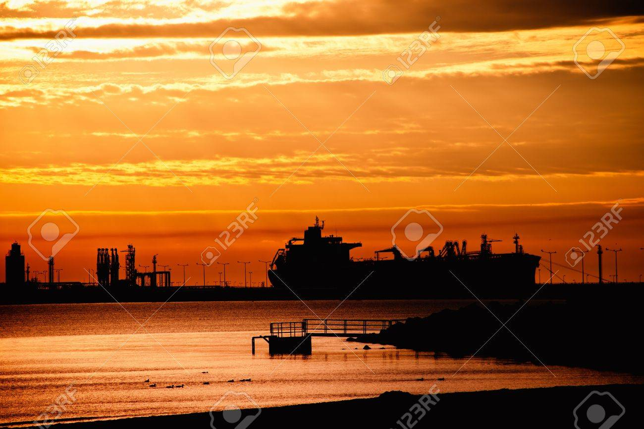 Tanker ship on the background of the rising sun. Stock Photo - 12007249